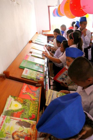 book choosing time in a room to read laos library